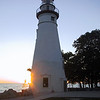 Marblehead Lighthouse, with the rising sun behind it.